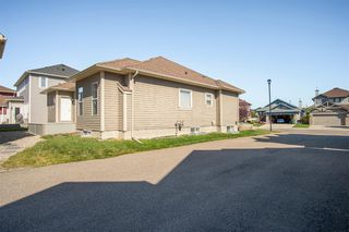 Photo 48: 1033 CHANNELSIDE Way SW: Airdrie Detached for sale : MLS®# A1010658