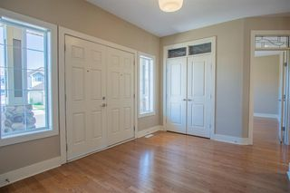 Photo 3: 1033 CHANNELSIDE Way SW: Airdrie Detached for sale : MLS®# A1010658