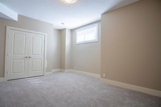 Photo 35: 1033 CHANNELSIDE Way SW: Airdrie Detached for sale : MLS®# A1010658