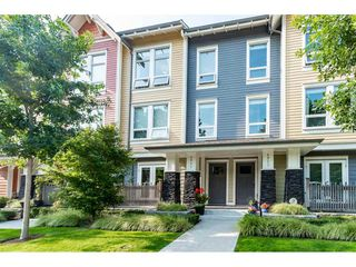 "Photo 1: 4901 47A Avenue in Delta: Ladner Elementary Townhouse for sale in ""VILLAGE WALK"" (Ladner)  : MLS®# R2481522"