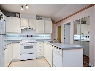 """Photo 3: 208 1591 BOOTH Avenue in Coquitlam: Maillardville Condo for sale in """"LE LAURENTIAN"""" : MLS®# V994679"""