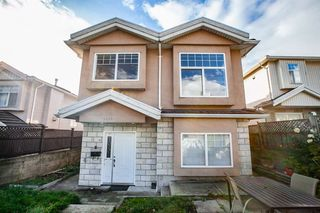 Photo 1: 7845 FRASER STREET in Vancouver: South Vancouver House 1/2 Duplex for sale (Vancouver East)  : MLS®# R2320801