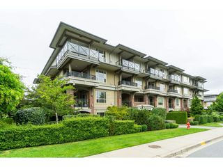 "Photo 1: 407 15357 17A Avenue in Surrey: King George Corridor Condo for sale in ""Madison"" (South Surrey White Rock)  : MLS®# R2479245"