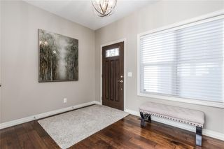 Photo 7: 219 AUBURN BAY Avenue SE in Calgary: Auburn Bay Detached for sale : MLS®# A1032222