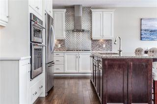 Photo 13: 219 AUBURN BAY Avenue SE in Calgary: Auburn Bay Detached for sale : MLS®# A1032222