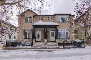 Photo 1: 2 127 27 Avenue NW in Calgary: Tuxedo Park Row/Townhouse for sale : MLS®# A1044558