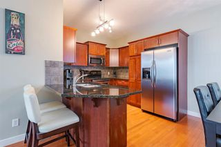 Photo 4: 2 127 27 Avenue NW in Calgary: Tuxedo Park Row/Townhouse for sale : MLS®# A1044558