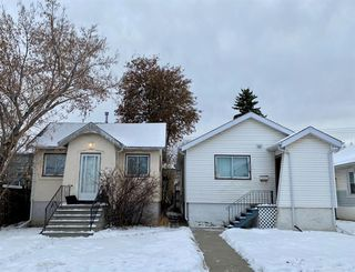 Main Photo: 115A 12 Avenue NW in Calgary: Crescent Heights Detached for sale : MLS®# A1051722