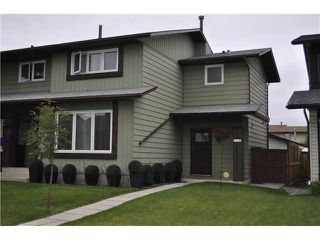 Photo 1: 559 SUMMERWOOD Place SE: Airdrie Residential Attached for sale : MLS®# C3580809