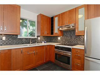 "Photo 1: 43 900 W 17TH Street in North Vancouver: Hamilton Townhouse for sale in ""FOXWOOD HILLS"" : MLS®# V971777"