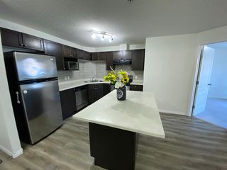 Photo 2: 7331 Terwillegar Dr in Edmonton: Condo for rent