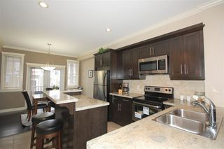 Photo 2: 69 16355 82 AVENUE in Surrey: Fleetwood Tynehead Townhouse for sale : MLS®# R2129490