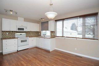 Photo 2: 7303 132 AV NW: Edmonton House for sale : MLS®# E4014283