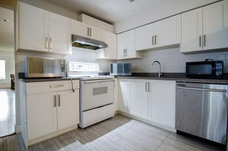 Photo 9: 7580 4TH Street in Burnaby: East Burnaby House 1/2 Duplex for sale (Burnaby East)  : MLS®# R2474331