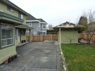 "Photo 9: 4710 215A Street in Langley: Murrayville House for sale in ""Macklin Corners"" : MLS®# F1303263"
