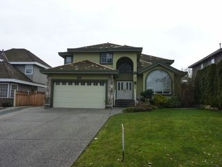 "Photo 1: 4710 215A Street in Langley: Murrayville House for sale in ""Macklin Corners"" : MLS®# F1303263"