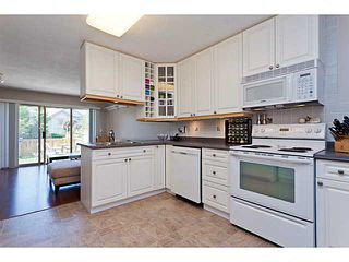 """Photo 9: # 58 1255 RIVERSIDE DR in Port Coquitlam: Riverwood Townhouse for sale in """"RIVERWOOD GREEN"""" : MLS®# V1019194"""