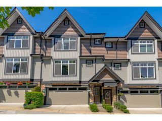 "Photo 1: 63 6299 144 Street in Surrey: Sullivan Station Townhouse for sale in ""Altura"" : MLS®# R2482013"