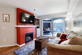 """Photo 1: 110 400 KLAHANIE Drive in Port Moody: Port Moody Centre Condo for sale in """"THE TIDES"""" : MLS®# R2470181"""