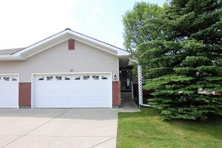 Photo 1: 11 SCOTIA Landing NW in Calgary: Scenic Acres Semi Detached for sale : MLS®# A1016434