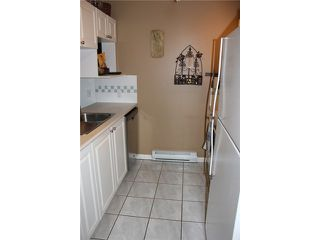 "Photo 2: 106 929 W 16TH Avenue in Vancouver: Fairview VW Condo for sale in ""OAKVIEW GARDENS"" (Vancouver West)  : MLS®# V978752"