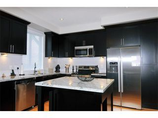 "Photo 2: 115 1460 SOUTHVIEW Street in Coquitlam: Burke Mountain Townhouse for sale in ""CEDAR CREEK"" : MLS®# V984770"
