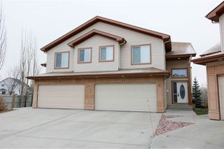 Photo 1: 2 2815 34 Avenue in Edmonton: Zone 30 House Half Duplex for sale : MLS®# E4207549