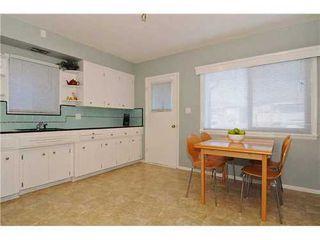Photo 6: 2411 ADANAC Street in Vancouver East: Renfrew VE Home for sale ()  : MLS®# V929941