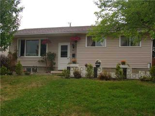 Photo 1: 707 58 Street SE in Calgary: Penbrooke Residential Detached Single Family for sale : MLS®# C3631943