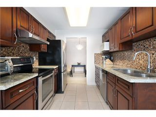 Photo 9: # 202 2668 ASH ST in Vancouver: Fairview VW Condo for sale (Vancouver West)  : MLS®# V1026379