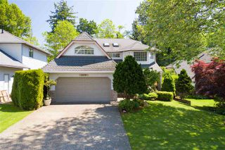Photo 1: 8678 141 STREET in Surrey: Bear Creek Green Timbers House for sale : MLS®# R2387042