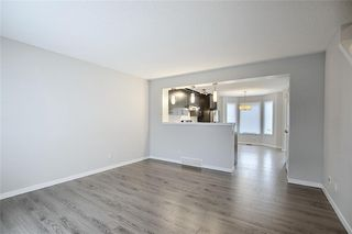 Photo 4: 208 AUBURN MEADOWS Boulevard SE in Calgary: Auburn Bay Semi Detached for sale : MLS®# C4295502
