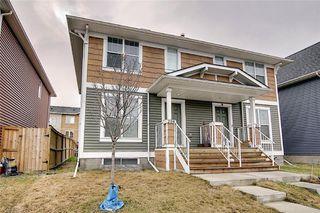 Photo 1: 208 AUBURN MEADOWS Boulevard SE in Calgary: Auburn Bay Semi Detached for sale : MLS®# C4295502
