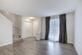 Photo 6: 208 AUBURN MEADOWS Boulevard SE in Calgary: Auburn Bay Semi Detached for sale : MLS®# C4295502