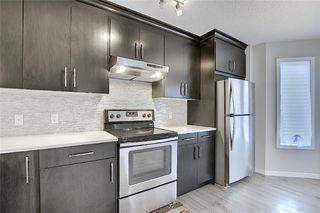 Photo 11: 208 AUBURN MEADOWS Boulevard SE in Calgary: Auburn Bay Semi Detached for sale : MLS®# C4295502