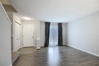 Photo 7: 208 AUBURN MEADOWS Boulevard SE in Calgary: Auburn Bay Semi Detached for sale : MLS®# C4295502