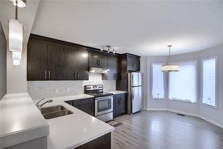 Photo 12: 208 AUBURN MEADOWS Boulevard SE in Calgary: Auburn Bay Semi Detached for sale : MLS®# C4295502