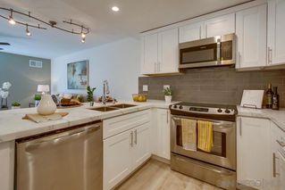 Photo 2: LA JOLLA Condo for sale : 1 bedrooms : 8268 Gilman Dr #11