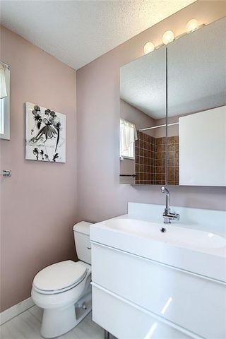 Photo 27: 128 MILLSIDE Drive SW in Calgary: Millrise Detached for sale : MLS®# C4296698