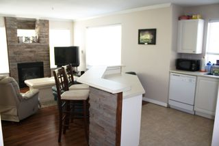 Photo 10: 307 33407 TESSARO Crescent in Abbotsford: Central Abbotsford Condo for sale : MLS®# F1212131