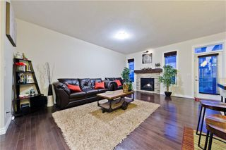Photo 4: NOLANCREST GR NW in Calgary: Nolan Hill House for sale