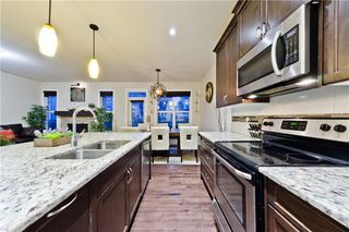 Photo 10: NOLANCREST GR NW in Calgary: Nolan Hill House for sale