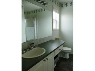 Photo 11: 52 WEST HALL Place: Cochrane Residential Detached Single Family for sale : MLS®# C3553892
