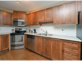 "Photo 5: 118 32725 GEORGE FERGUSON Way in Abbotsford: Abbotsford West Condo for sale in ""Uptown"" : MLS®# F1417772"