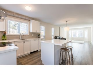 "Photo 2: 1228 RIVER Drive in Coquitlam: River Springs House for sale in ""RIVER SPRINGS"" : MLS®# R2449831"