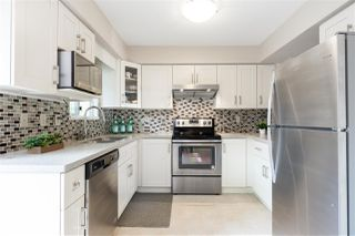 "Photo 1: 12 7711 MINORU Boulevard in Richmond: Brighouse South Townhouse for sale in ""OAK TREE LANE"" : MLS®# R2388984"