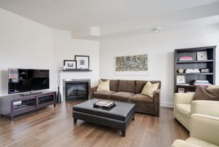 Photo 3: 3 29 SPRINGBOROUGH Boulevard SW in Calgary: Springbank Hill Row/Townhouse for sale : MLS®# A1012548