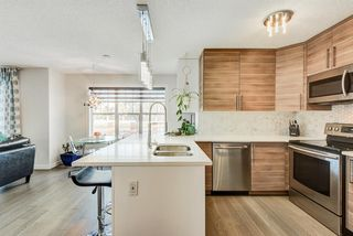 Photo 6: 1503 7171 Coach Hill Road SW in Calgary: Coach Hill Row/Townhouse for sale : MLS®# A1059178