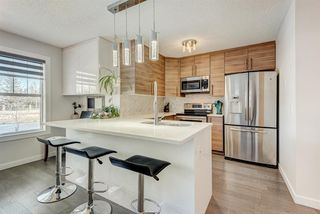 Photo 3: 1503 7171 Coach Hill Road SW in Calgary: Coach Hill Row/Townhouse for sale : MLS®# A1059178