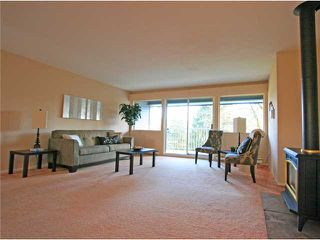 "Photo 1: 1053 CECILE Drive in Port Moody: College Park PM Townhouse for sale in ""CECILE HEIGHTS"" : MLS®# V931590"